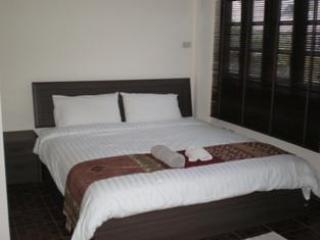 large queen size bed and sofa bed in 2 ensuite master bedrooms, balcony overlooking pool, & gardens