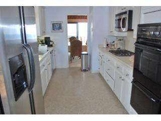 Kitchen facing towards Dining Room, and Ocean Views- all you need is included!