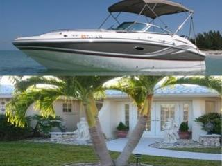 Deck Boat with Beautiful Yacht Club Home