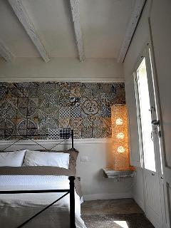 Ground floor bedroom with ancient sicilian majolica