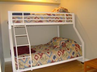 2nd bedroom features single over double bunk beds
