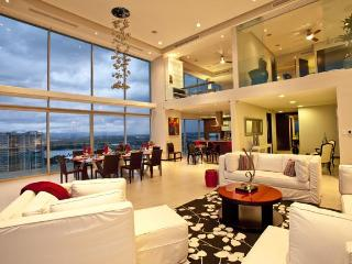 The atrium and kitchen enjoy killer views over the ocean and marina.
