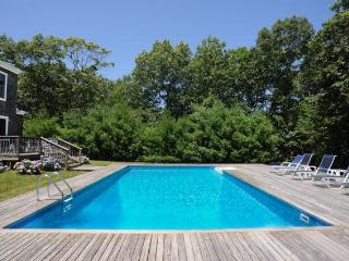 Private heated swimming pool receives full sun. Surrounded by spacious decking and lawn.