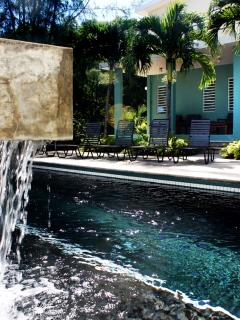 You'll love the soothing sound of our pool's waterfall.