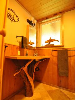 Juniper limb under sink in one of the master baths