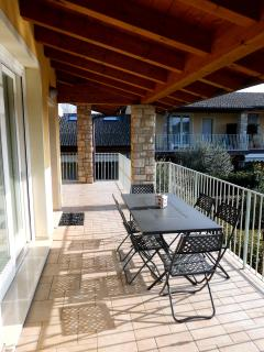 Huge terrace overlooking pool - perfect for al fresco dining!
