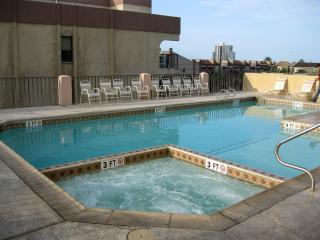 Family pool and hot tub located on the south side of the building located on the third floor