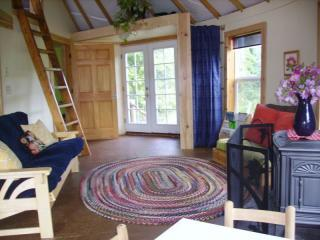 Living room with pull out full sized futon. Pellet stove keeps the yurt cozy all winter
