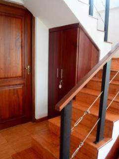 The stairway leads to the pantry and dining area