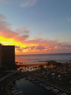 Sunrise over Waikiki in front of this condo