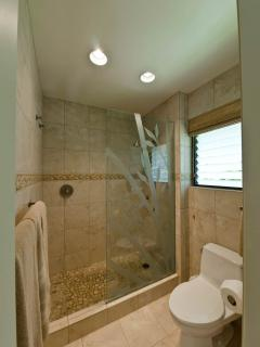 The master bath features a private room with a walk-in shower with bamboo etched glass & toilet.