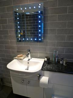 Basin and mirror with shaver point and demister