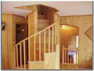 Spiral staircase to upper bedroom