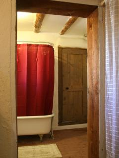 Guest bathroom with antique clawfoot tub and shower