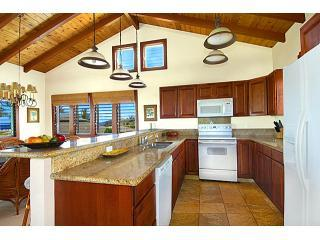 Akala Pua\'s Kitchen has Granite Countertops and an Ocean View