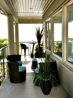 Wrap around veranda allows intimate areas to relax~great space for everyone~Blankets included.