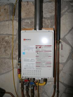 A tankless water heater provides plenty of hot water for the shower and full bath.
