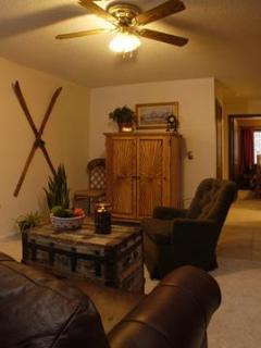 Ski Town Condos living room: Amenities include Dish TV top 120, DVD player, and wifi.