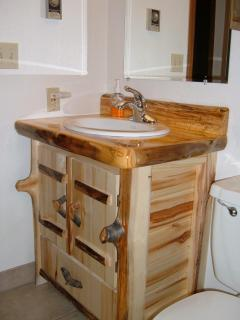Rustic Log bathroom cabinets in units A & C.