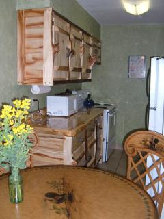 Rustic Log Kitchen Cabinets with dishwashers in Unit A and C.