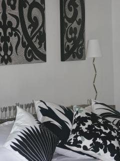 Bedroom two features black and white art and furnishings