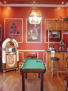 another entertainment room with juke box, mini pool table, luxury board games, and more