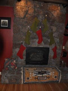 Christmas stockings hung by the fire