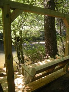sit and relax by the river on the new swing