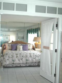 Comfy Master Bedroom with French doors
