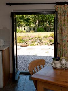 LOOKING OUT THROUGH VINE'S KITCHEN DOOR TO THE ROCKERY