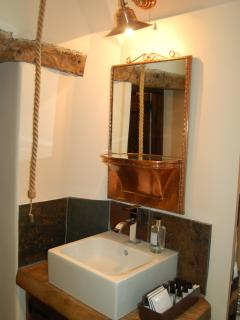 Bathroom with 1920s copper cruise ship mirror