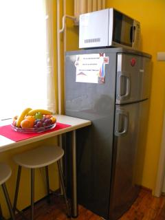 Separate kitchen, with a fridge and a mocrowave.