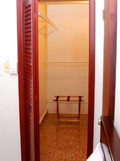 REDDISH ROOM CLOSET.
