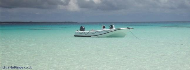 Our boat beached at Mnemba Island
