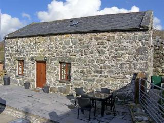 ISALLT, pet friendly, character holiday cottage, with a garden in Llanfair, Ref 4082