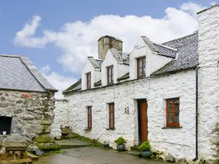 HEN ARGOED COTTAGE, pet friendly, character holiday cottage, with a garden in Llanfair, Ref 4131
