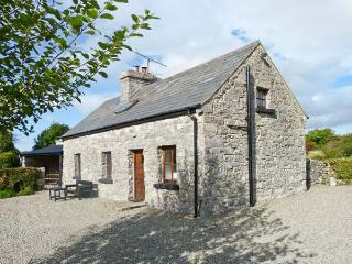 CLOONCORRAUN COTTAGE, pet friendly, character holiday cottage, with a garden in