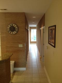 Kitchen Clock and Hallway