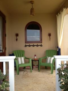 Private Covered Porch - great spot in the shade to enjoy the ocean views and relax/read.