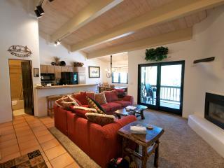 Main floor family room, dining room, breakfast bar seats 4