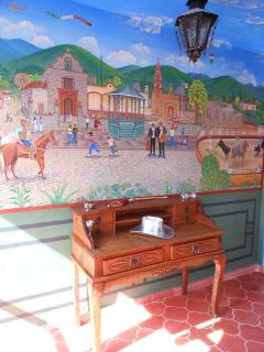 Privately commissioned mural of Ajijic village life livens the walls as you approach the bedroom.