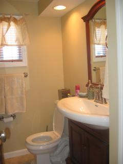 Bathroom Tile floor, vanity, linen closet & washer/dryer