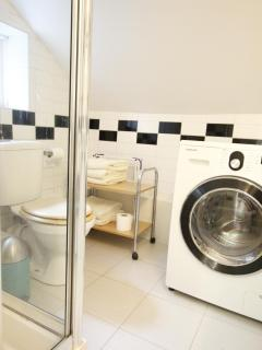 Shower room with washer dryer