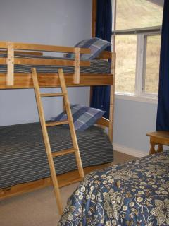 Two Loft Bedrooms with bunk and queen, overlooks ski runs.