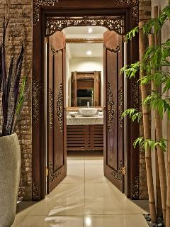 Balinese entrance doors from the living room to the guests toilet.