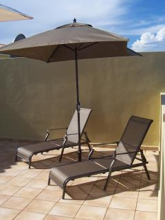 Sun Yourself in a Chaise Lounge on the Patio