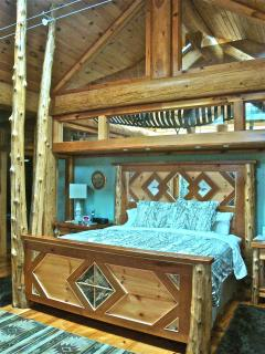 Handmade king bed with 12 foot cedar tree