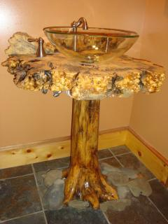 Pedestal sinks hand crafted from cedar stumps, burl tops and clear vessel sinks