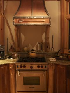 Custom kitchen with copper sinks, faucets and stove hood