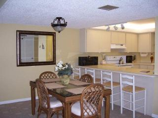 Kitchen with breakfast bar and dining room